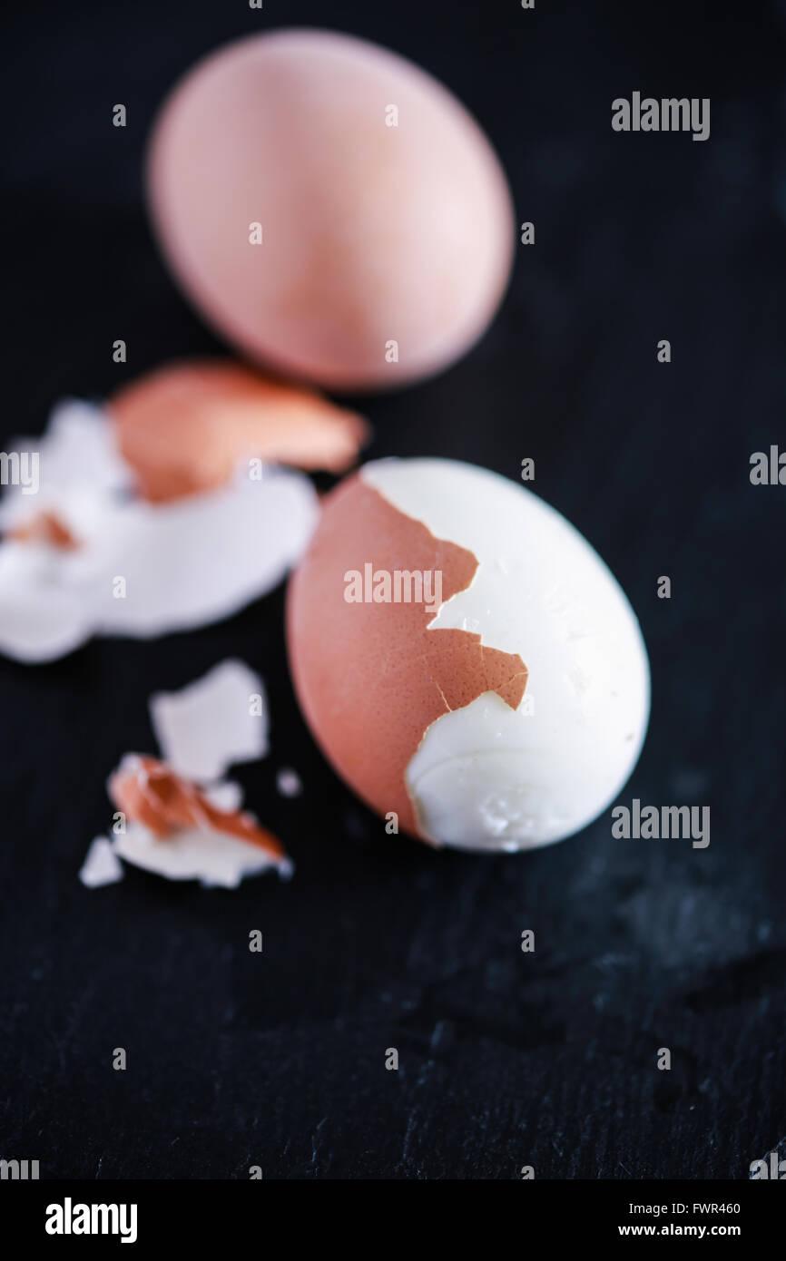 Hard boiled eggs peeled - Stock Image