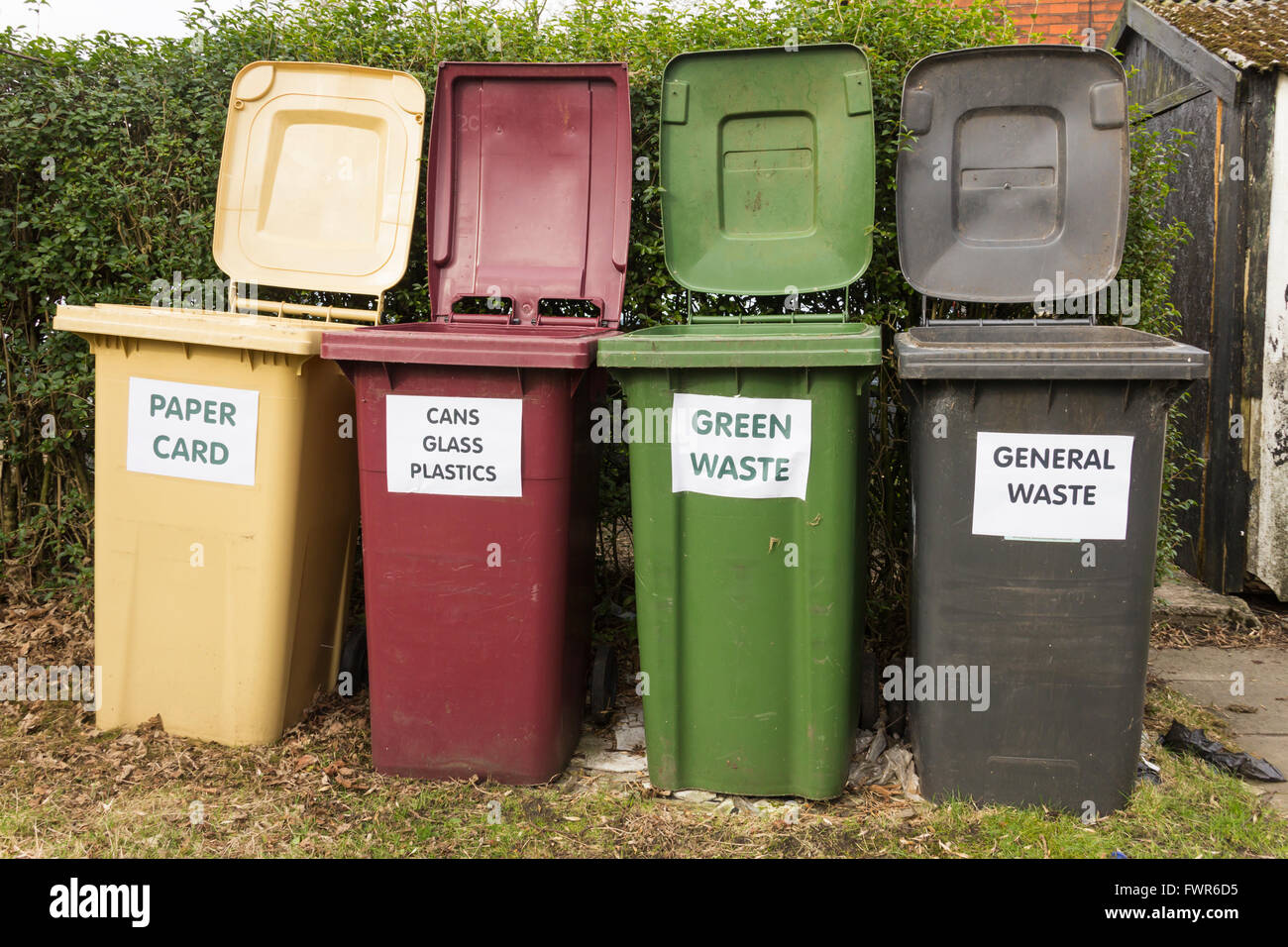 Domestic waste and recycling bins  for paper and card,  cans,  plastic and bottles, food and garden waste, and  Stock Photo