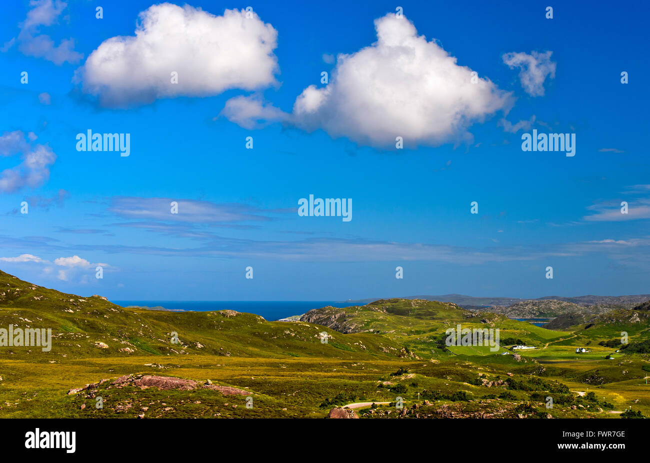 Hilly landscape in the Scottish Highlands at Lochinver, Assynt, Scotland, United Kingdom - Stock Image