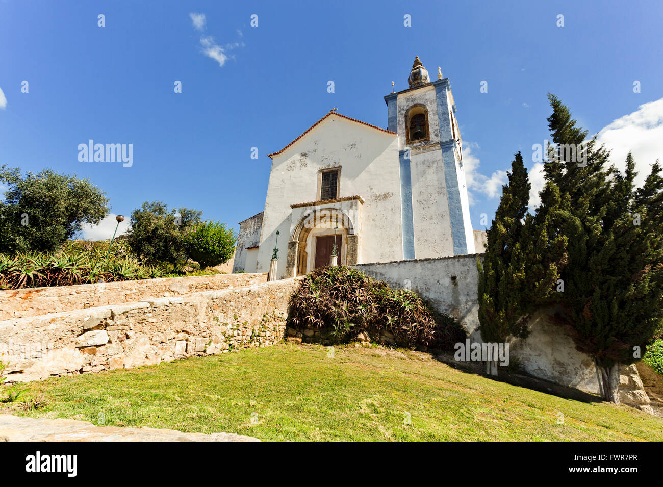 Facade of the Church of Saint Mary inside the walls of the castle of Torres Vedras, Portugal - Stock Image