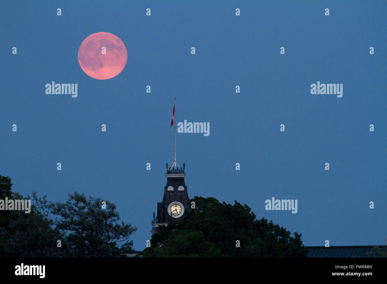 The Super Moon Rises Over The Clock Tower At Royal Military College