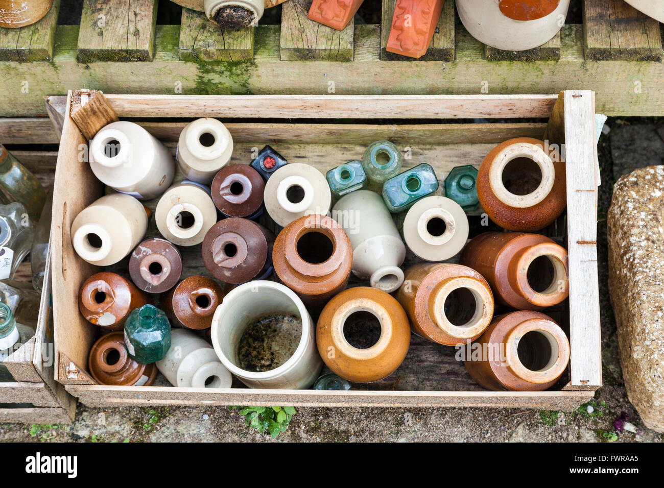 Wooden crate of old stoneware and glass bottles for sale - Stock Image