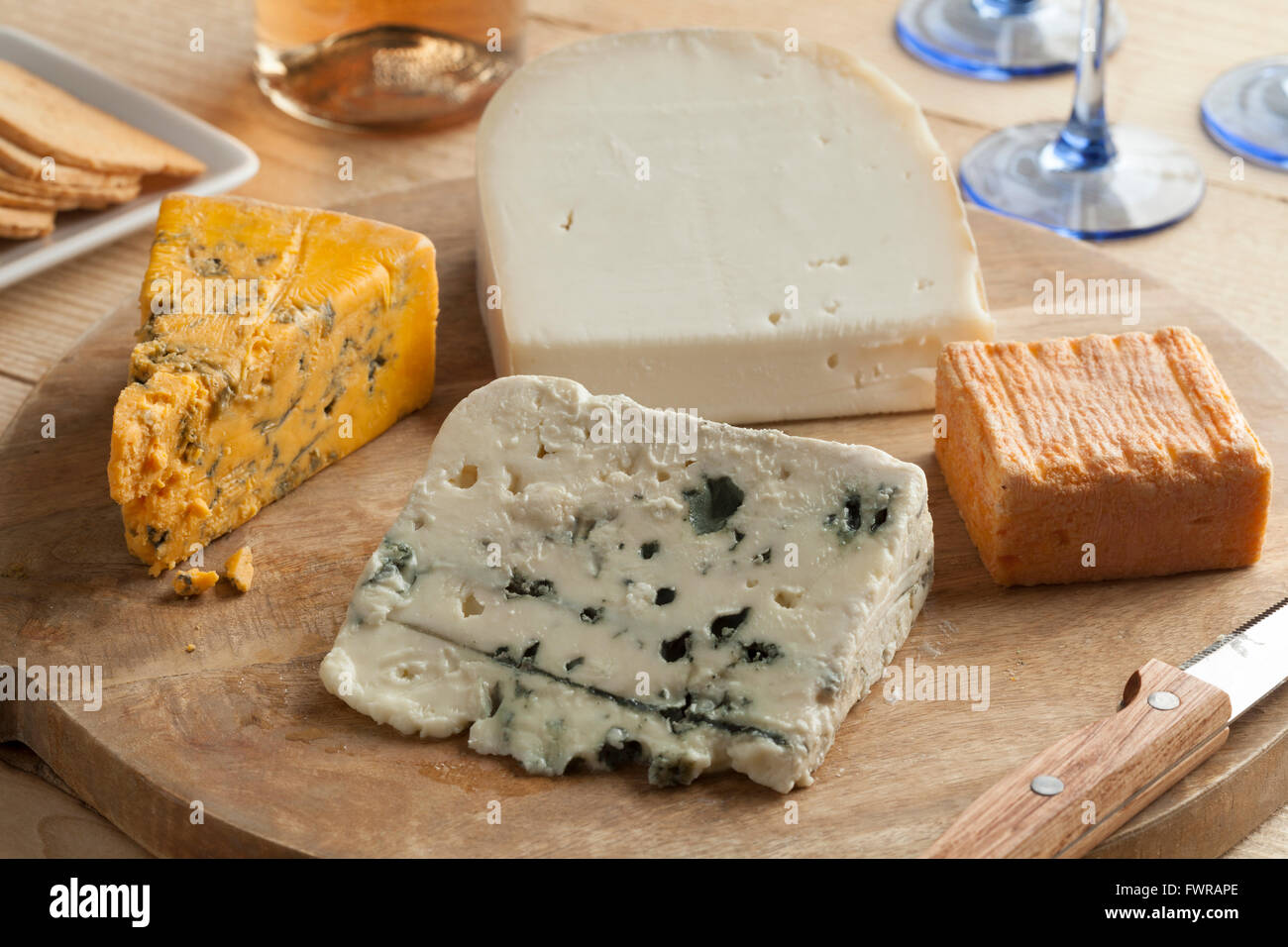Variety of cheese on a wooden board for dessert - Stock Image