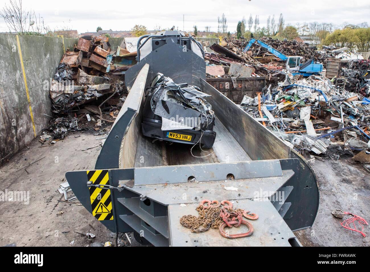 A car crusher in a metal scrap yard in England - Stock Image