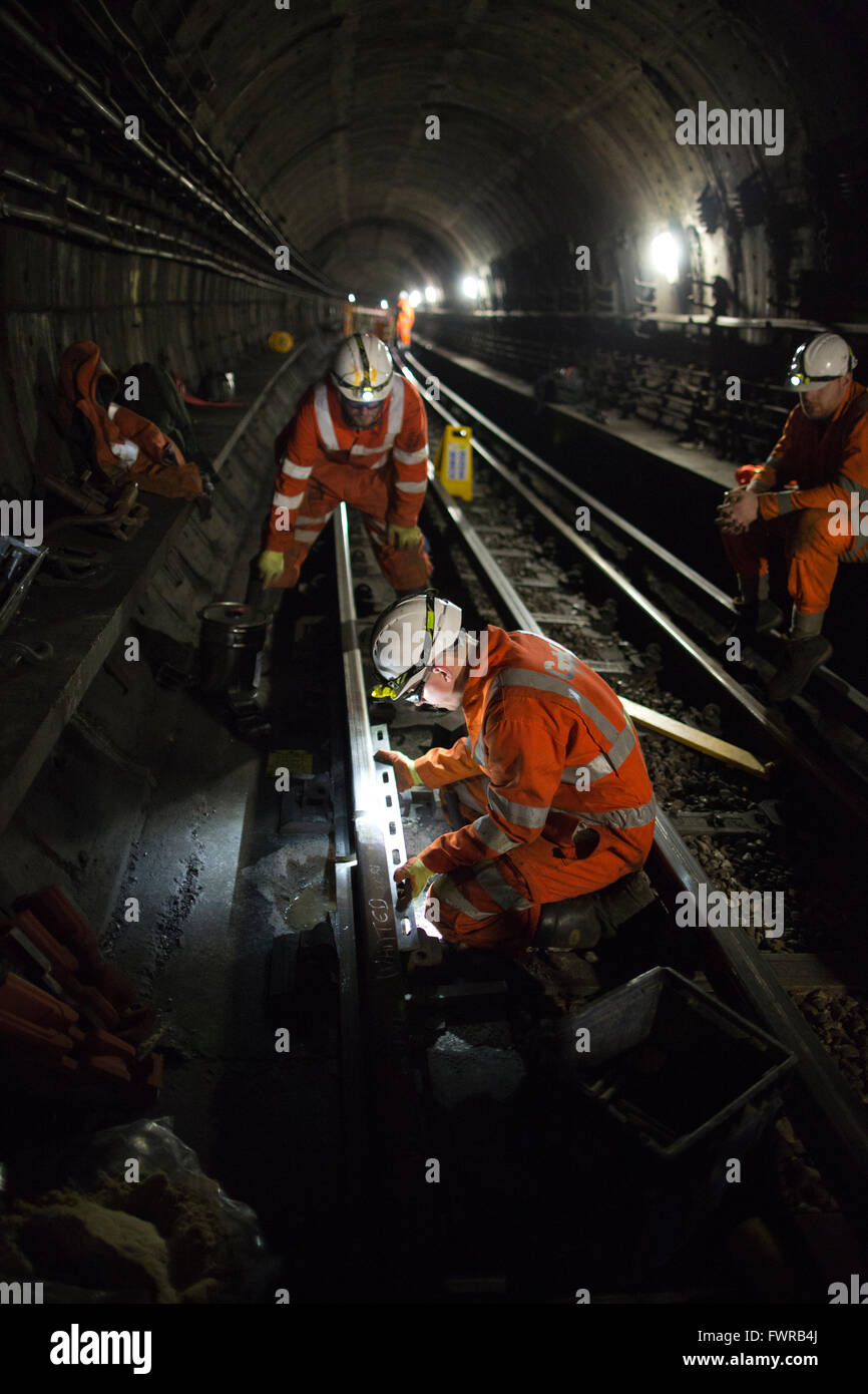Engineers prepare replacement track components before using thermite welding on London Underground rail track, London, - Stock Image