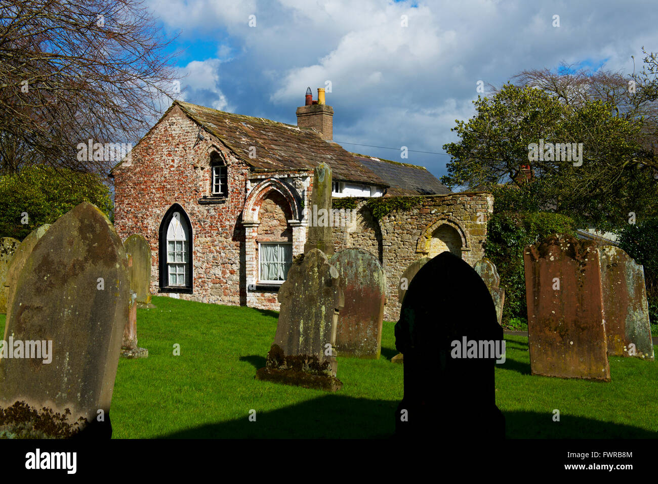 The old rectory next to St Michael's, a fortified church in the village of Burgh-by-Sands, North Cumbria, England - Stock Image