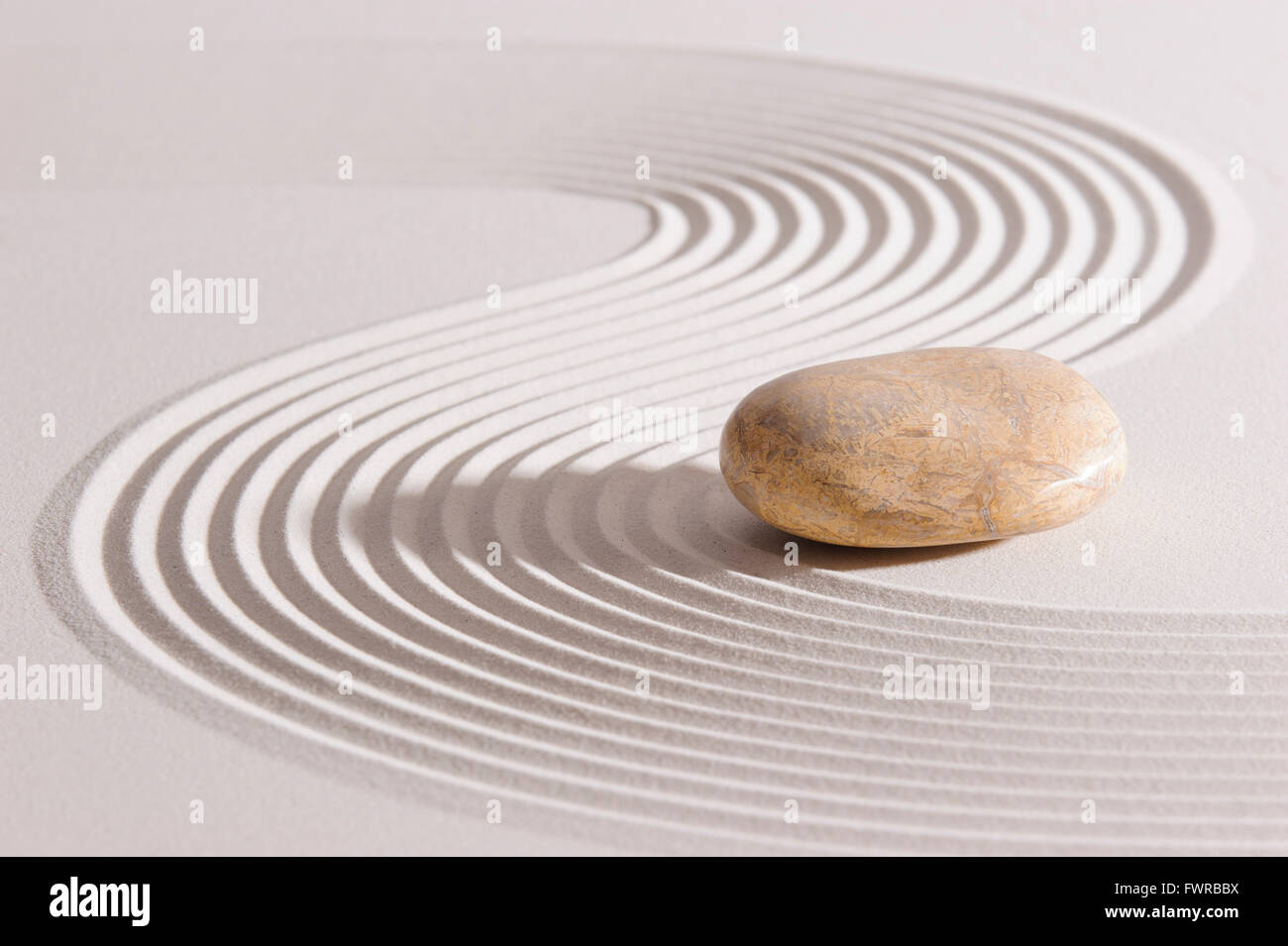 Japanese ZEN garden with stone in raked sand - Stock Image