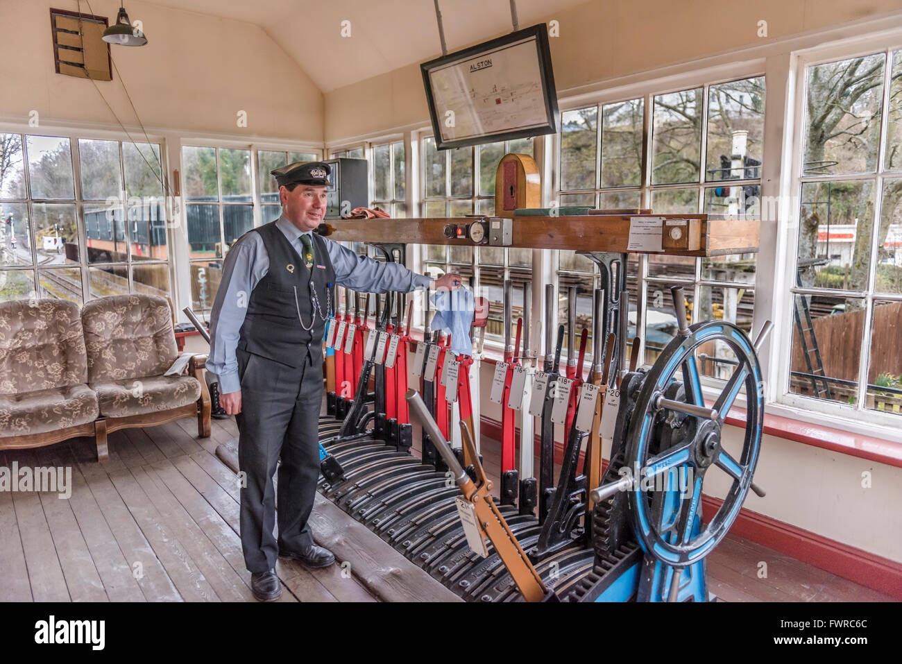 South Tynedale Railway running between Alston in Cumbria and Kirkhaugh in Northumberland. Signalman in signalbox. - Stock Image