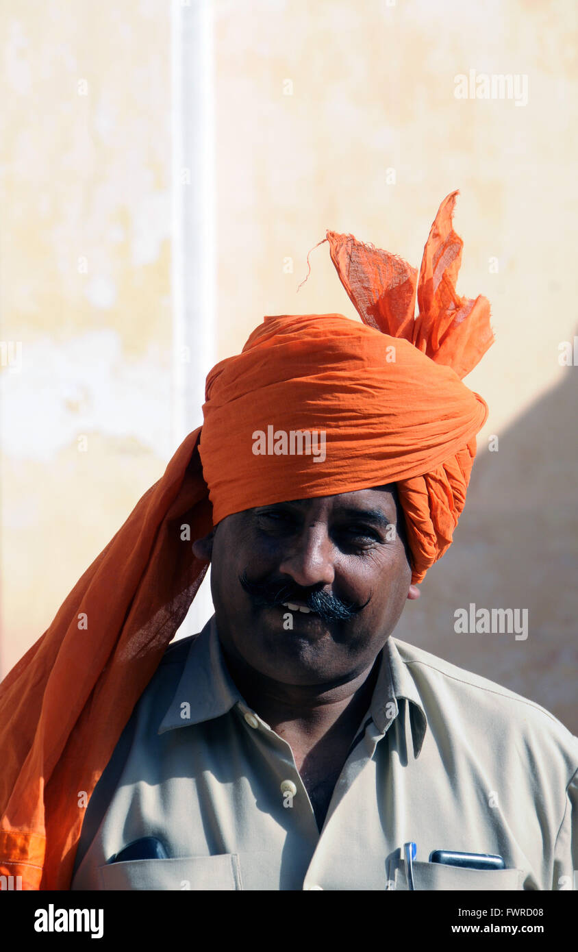 Tourists visiting the Meherangarh Fort near Jodhpur can watch a demonstration of how to put on a turban. - Stock Image