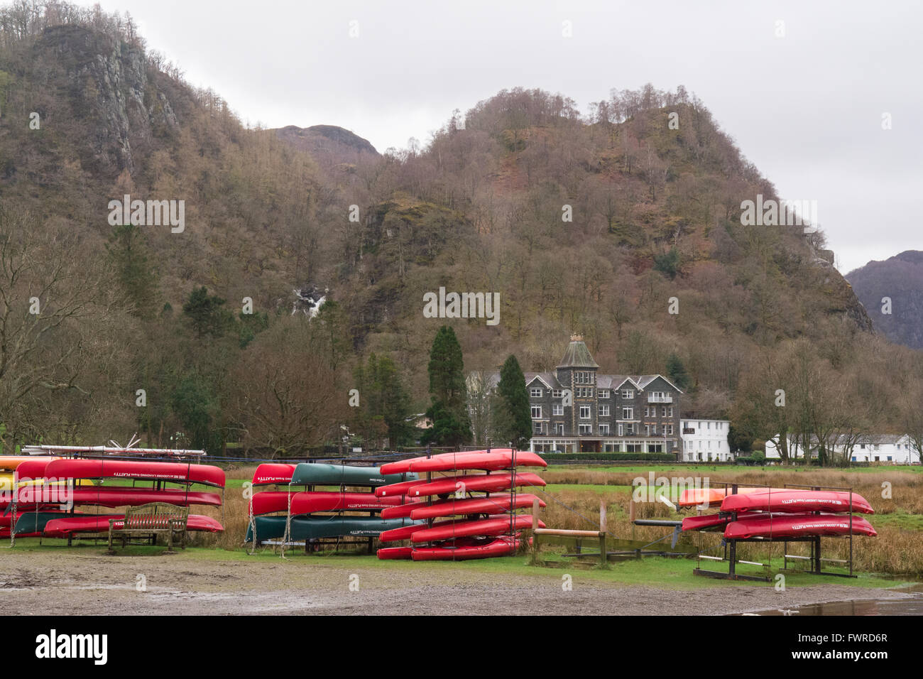 Canoes and Kayaks close to the Lodore Falls Hotel, with the Lodore falls on the left - Derwentwater, Lake District, - Stock Image