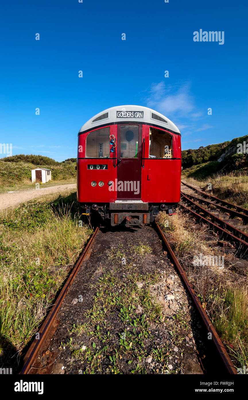 Former London Underground trains in the Mannez Quarry on the island of Alderney. - Stock Image