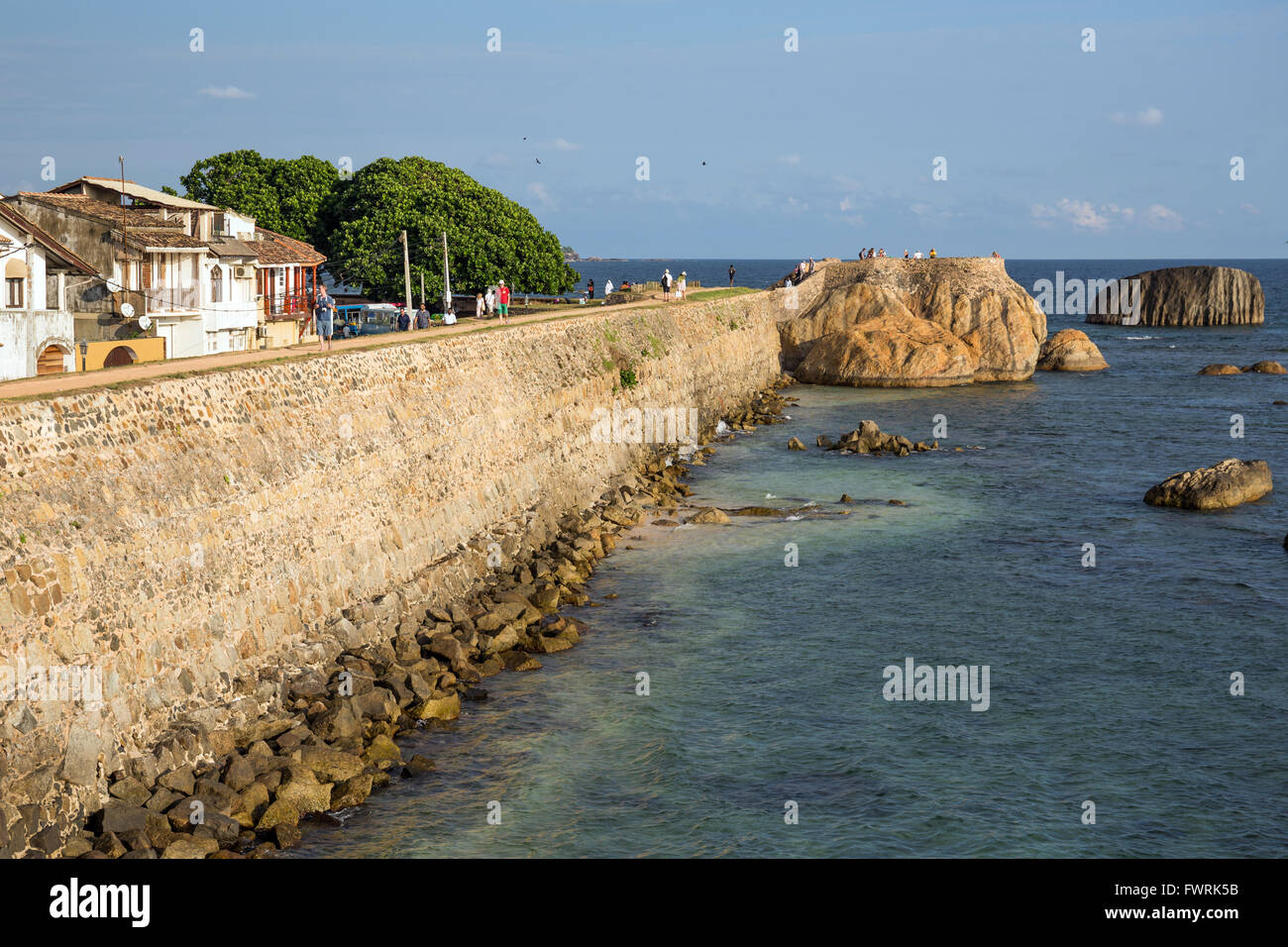 Galle Fort, listed as World heritage by UNESCO, old colonial houses behind the sea side walls of the fortified town, Stock Photo
