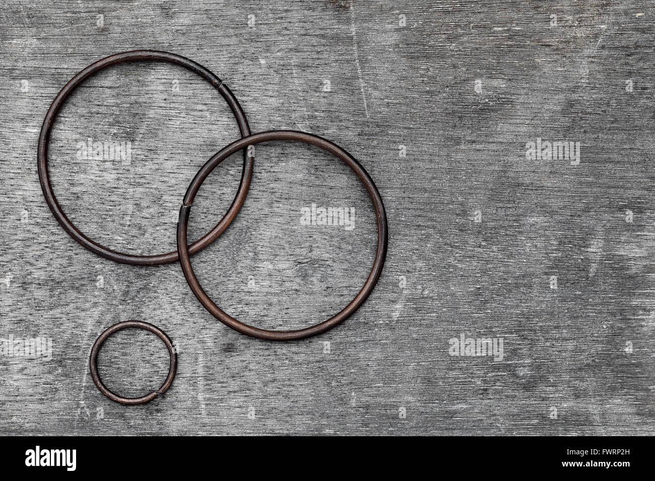 iron ring on old wood, grunge background Stock Photo