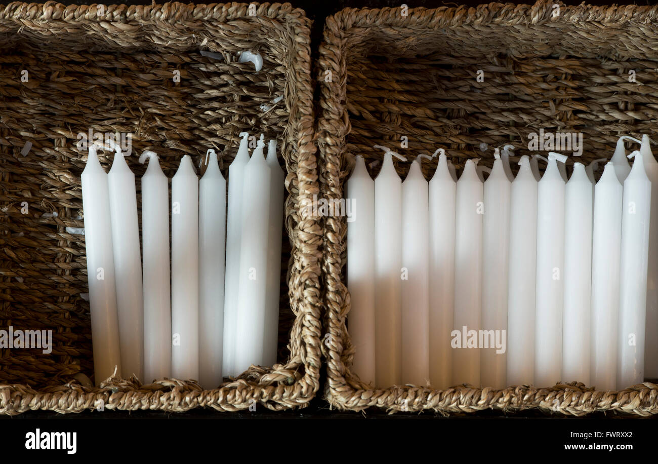 Prayer candles in baskets. Tewkesbury Abbey, Gloucestershire, England - Stock Image
