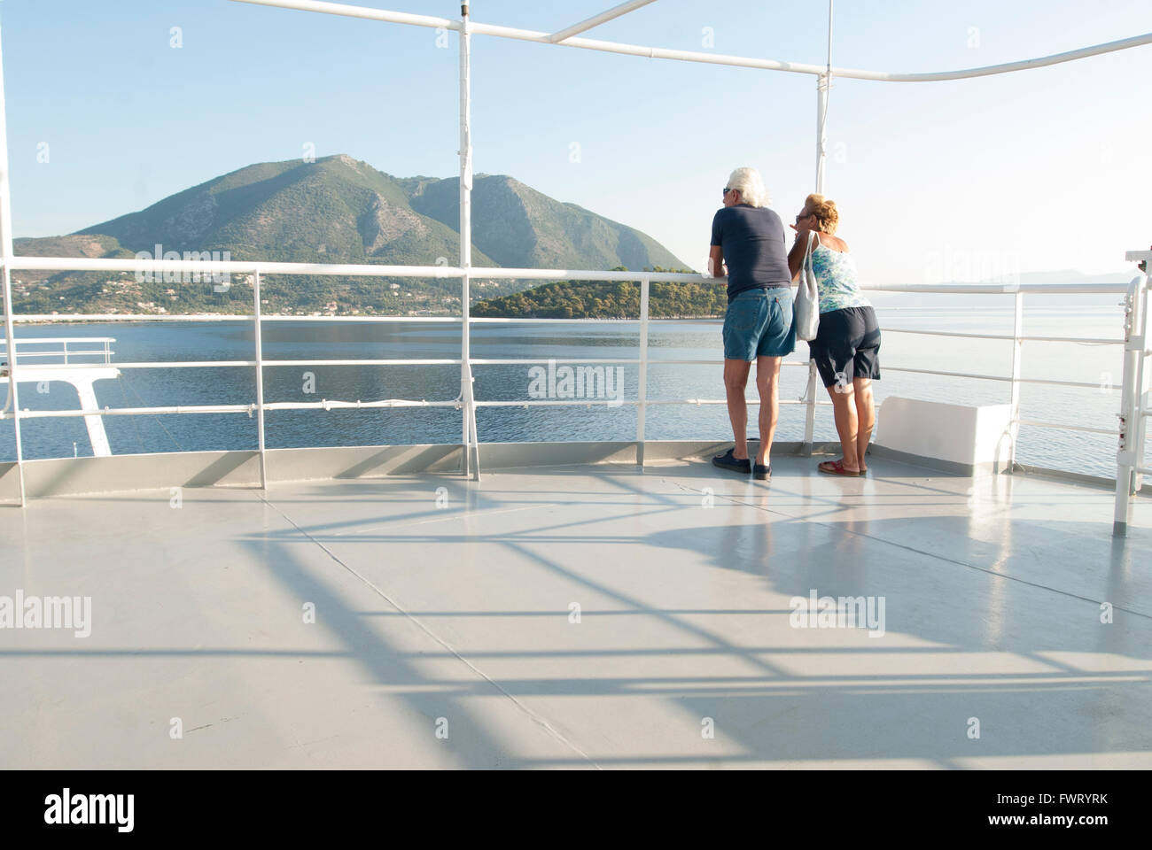 Retired mature couple traveling on a local Greek ferry - Stock Image