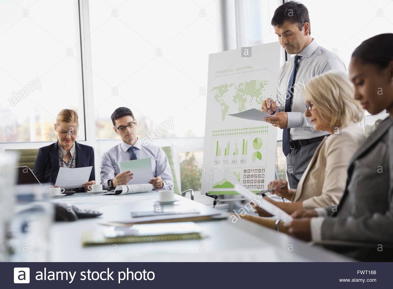 Multi-ethnic business people in boardroom meeting - Stock Image