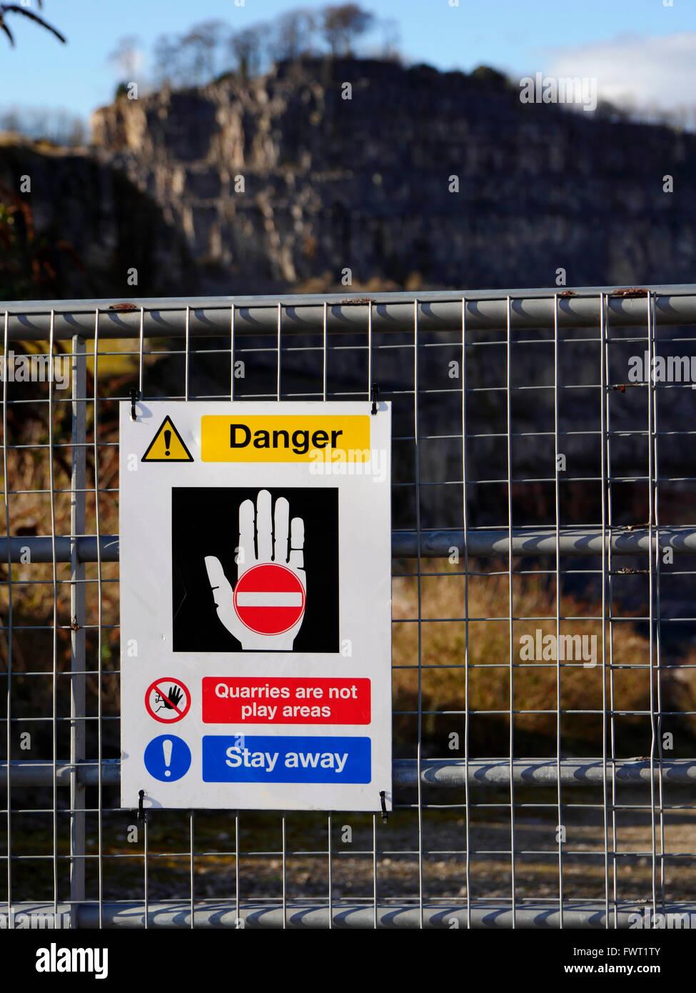 Danger sign limestone quarry at Wirksworth Cromford village town Peak District National Park, Derbyshire planning - Stock Image