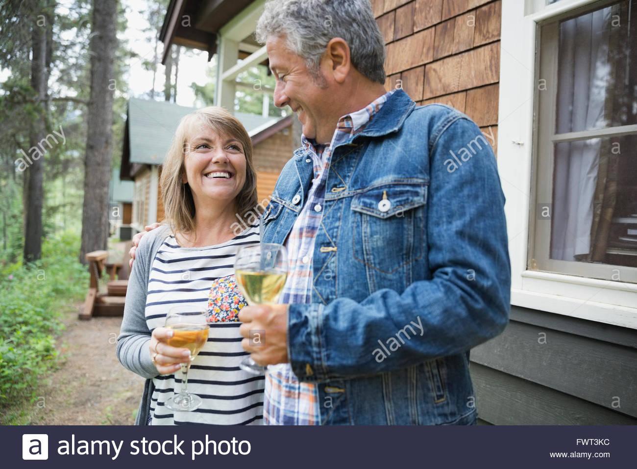 Happy couple drinking wine outdoors - Stock Image