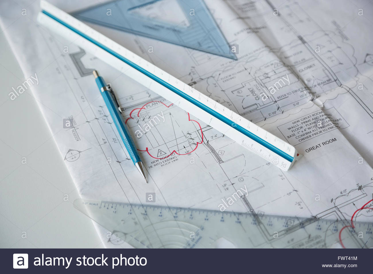 Blueprint and office supplies on table - Stock Image