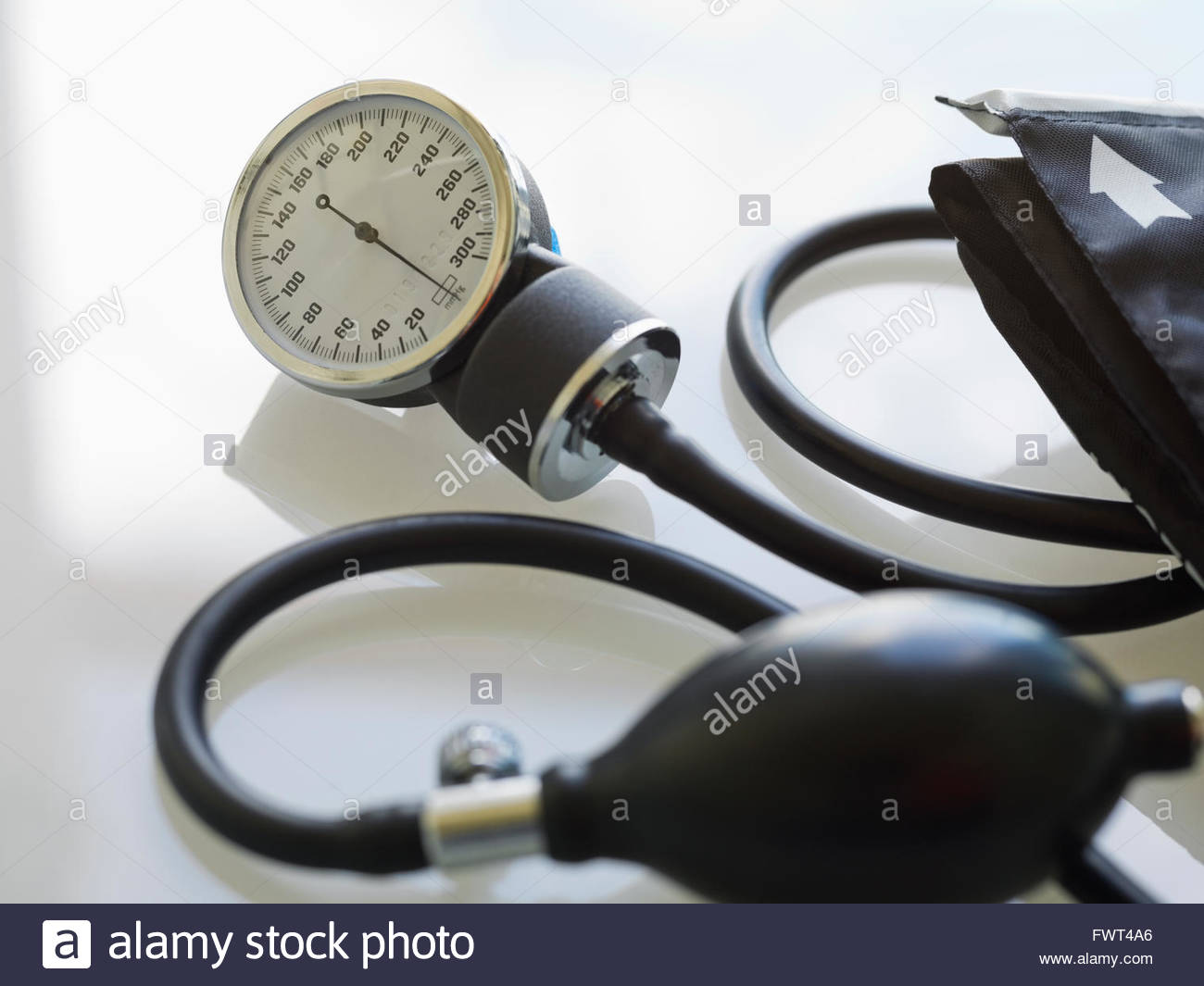 Blood pressure gauge with tube on white background - Stock Image