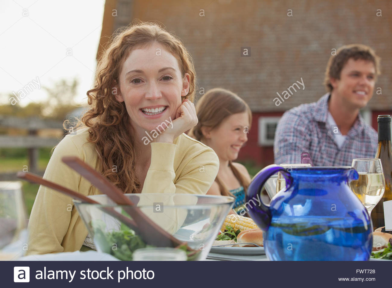 Portrait of pretty woman at outdoor family dinner. - Stock Image