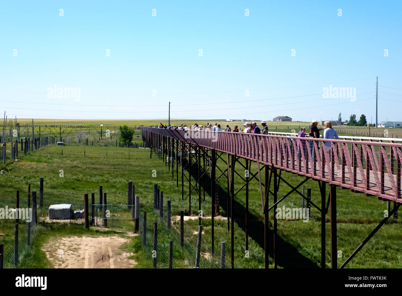 Visitors walk along the viewing area over various animal habitats at The Wild Animal Sanctuary. Stock Photo