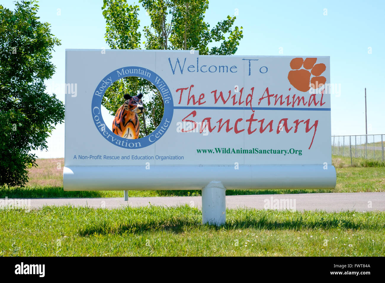 A sign greets visitors at the entrance of The Wild Animal Sanctuary and Rocky Mountain Wildlife Conservation Center Stock Photo