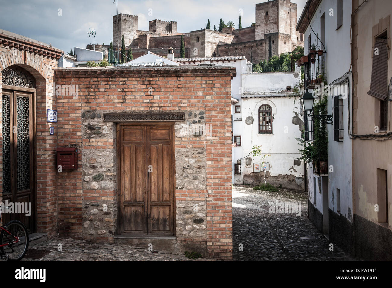 View of Alhambra castle in background from Albacin district in Granada city, Spain - Stock Image
