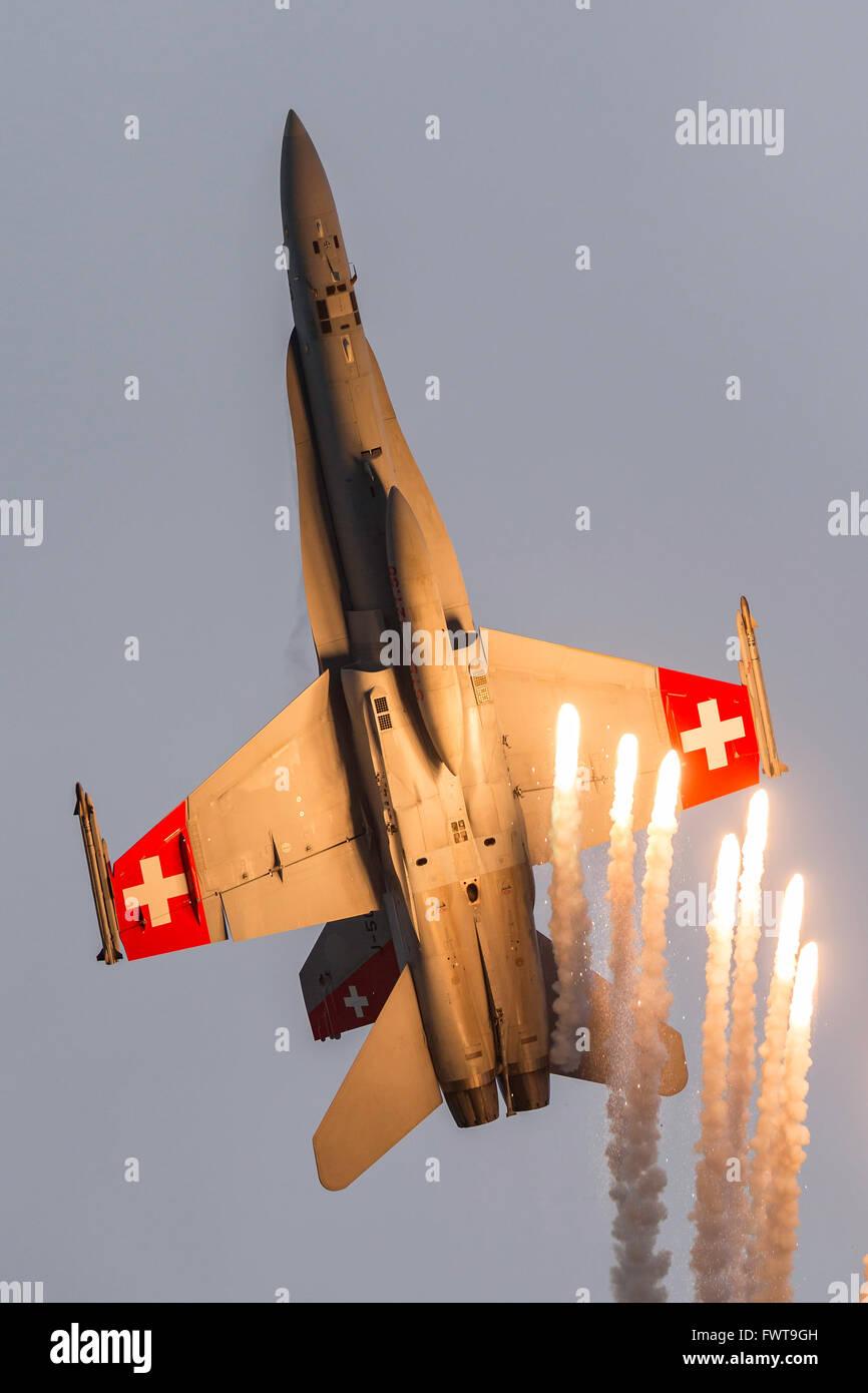 Swiss Air Force McDonnell Douglas F/A-18C Hornet J-5014 firing countermeasure flares. - Stock Image