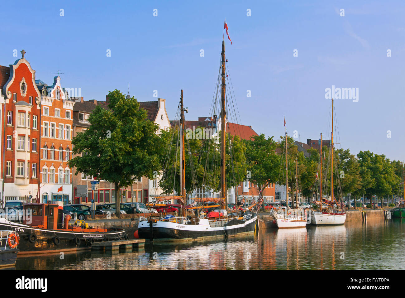 Museums harbour with traditional sailing ships berthed at the Untertrave in the Hanseatic town Lübeck, Germany - Stock Image