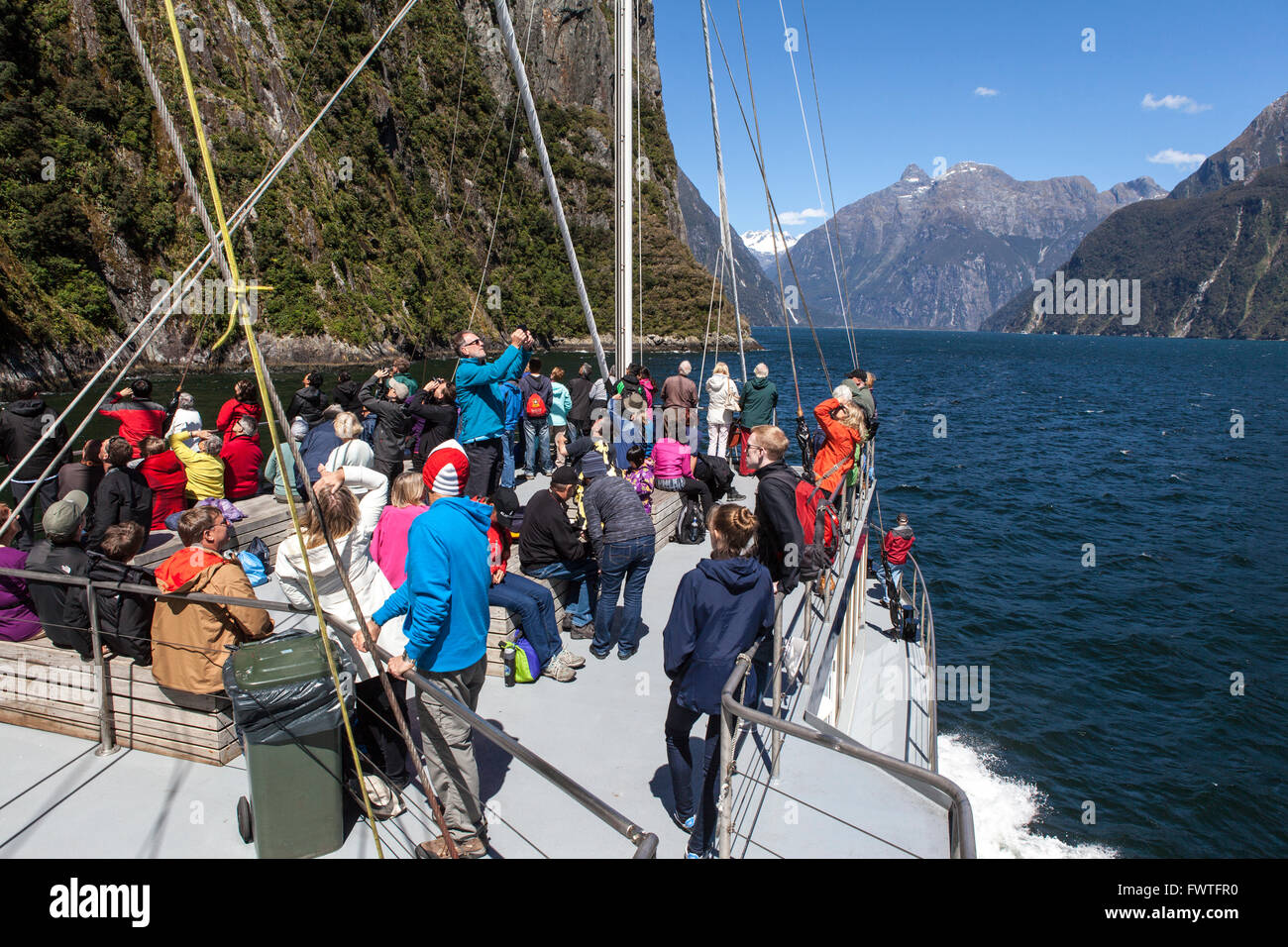 tourists on the ship in the Milford Sound, New Zealand - Stock Image