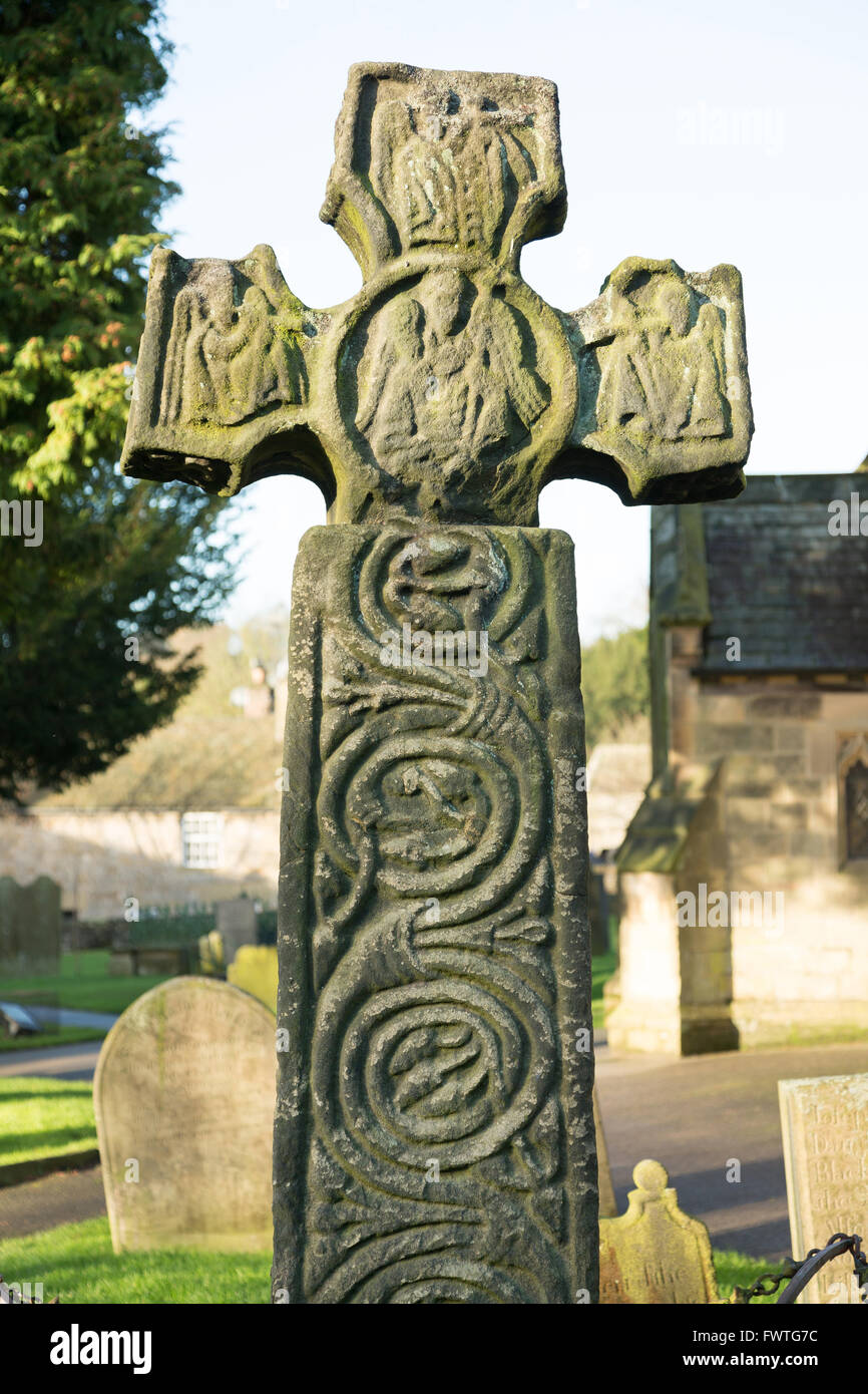 An ancient Celtic cross form the 9th Century in the Eyam Churchyard in Derbyshire, UK - Stock Image