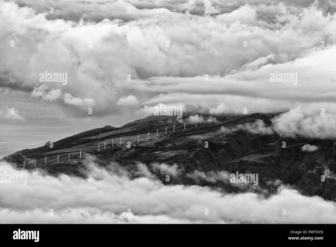 wind farm on West Maui Mountains seen from Haleakala Crater - Stock Image