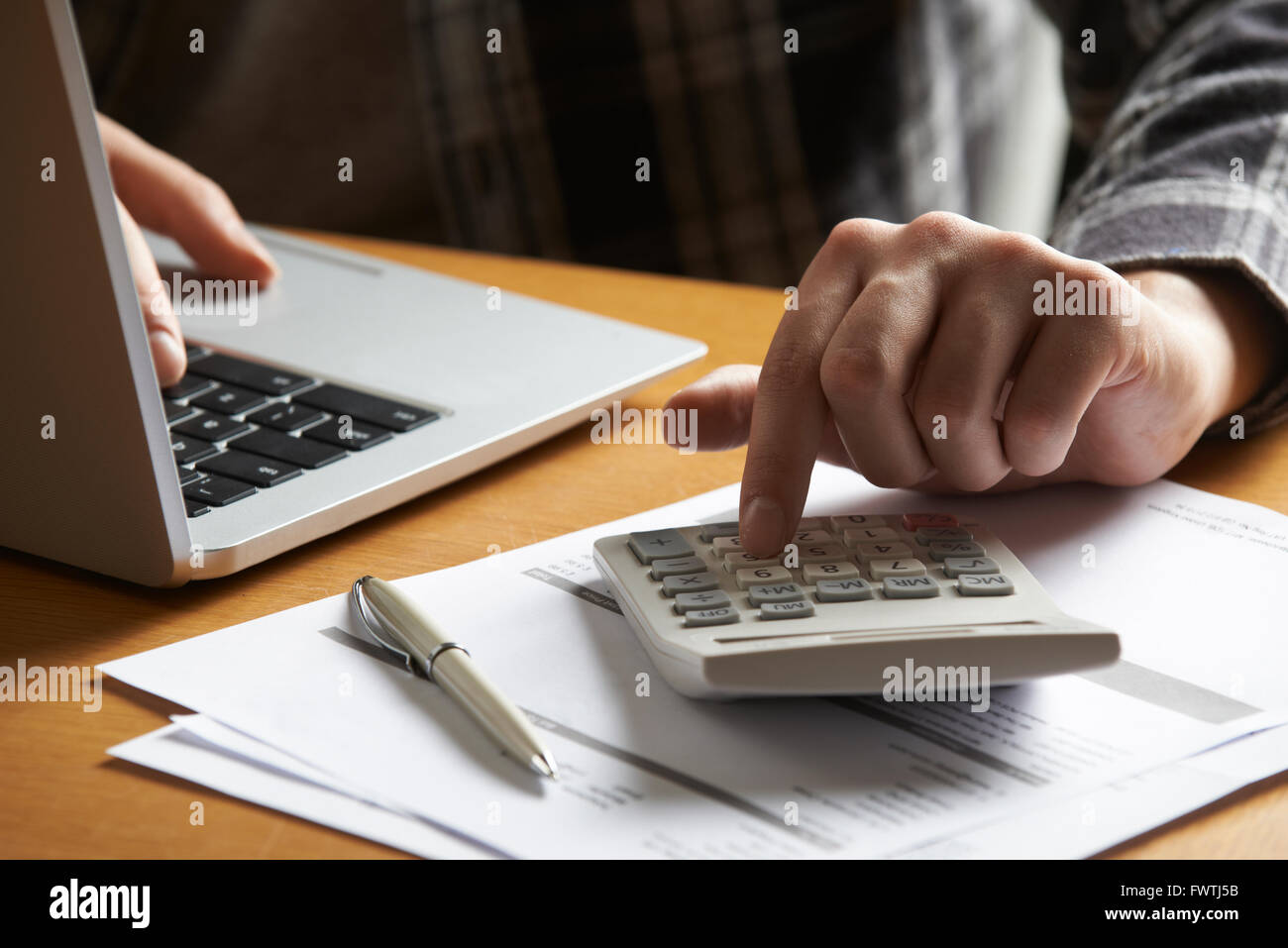 Man Working Out Household Finances - Stock Image
