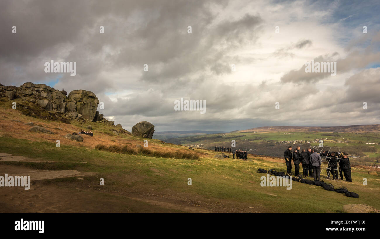 Young men undertaking team building exercises at the Cow and Calf, Ilkley - Stock Image