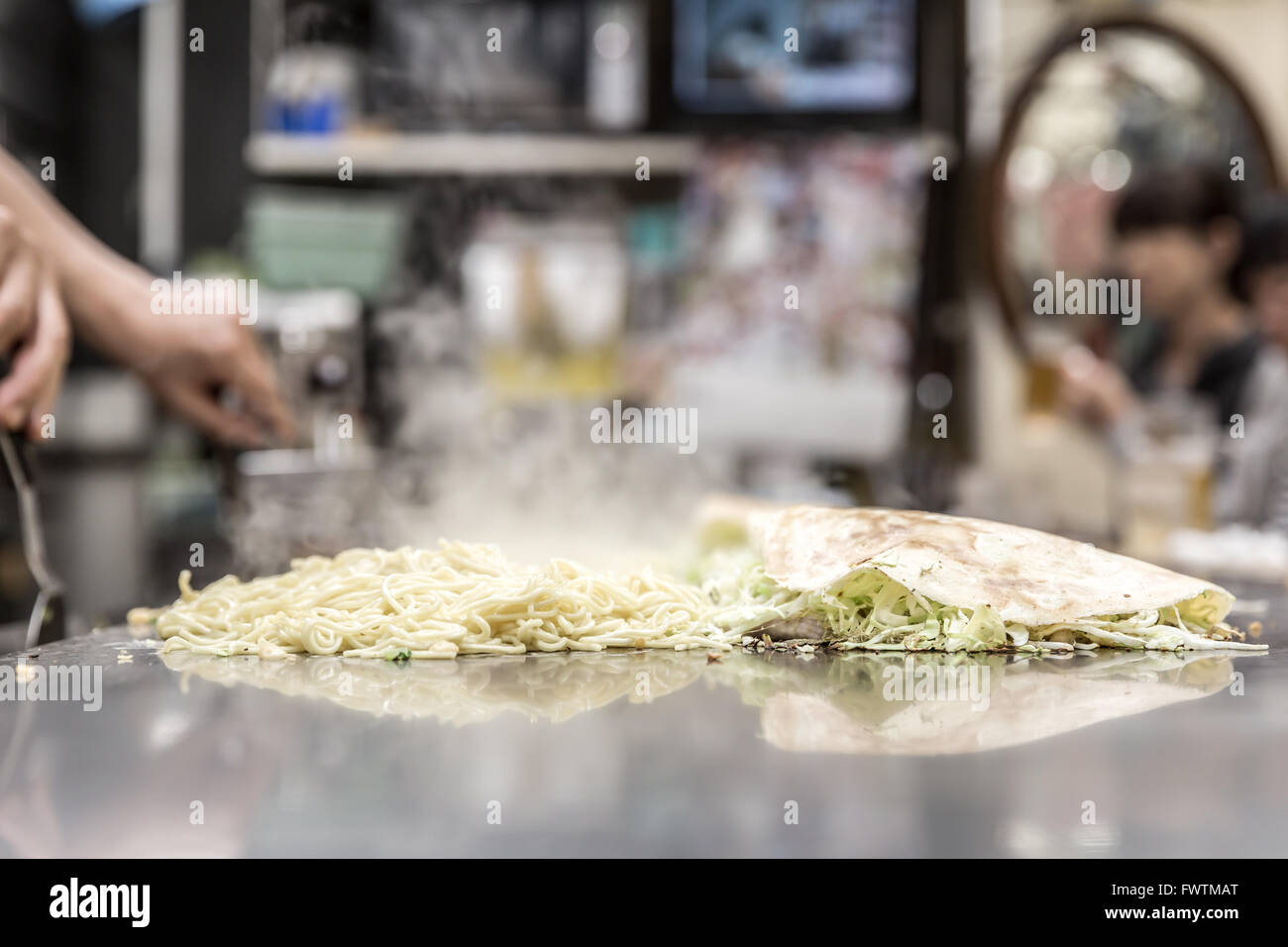 cooking of okonomiyaki japanese pizza Stock Photo