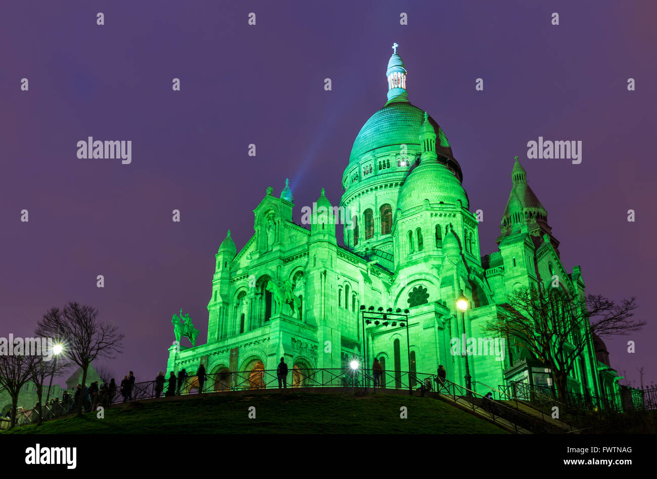 The Basilica of Sacre Coeur in Montmartre, Paris at night - Stock Image