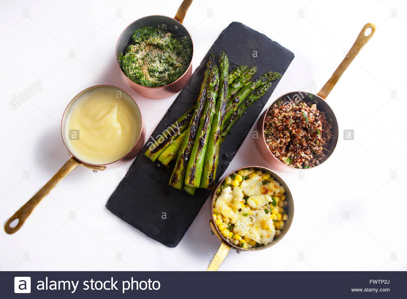 Cream of Spinach,French mash potatoes,Roasted couscous,roasted corn,grilled asparagus - Stock Image