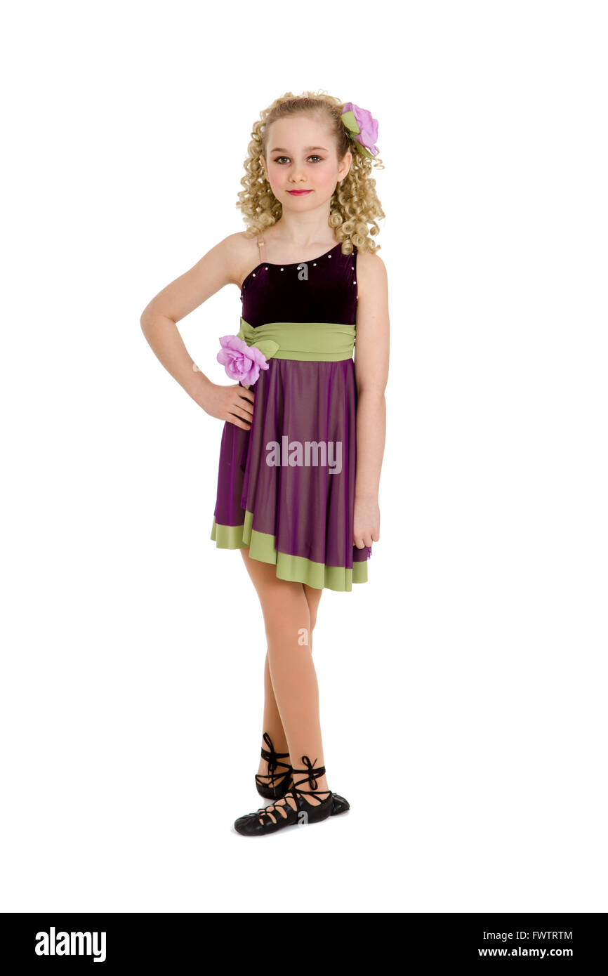 An Irish or Celtic Dancer Girl in Recital Costume, Ghillies and Curly Wig - Stock Image