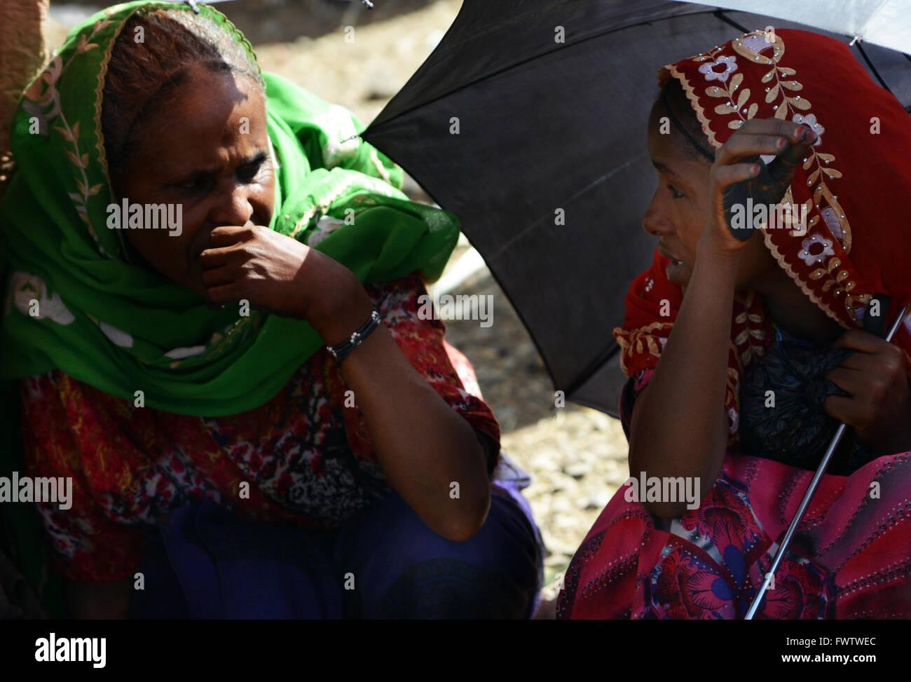 Oromo women under the umbrella in the colorful weekly market in Bati, Ethiopia. - Stock Image