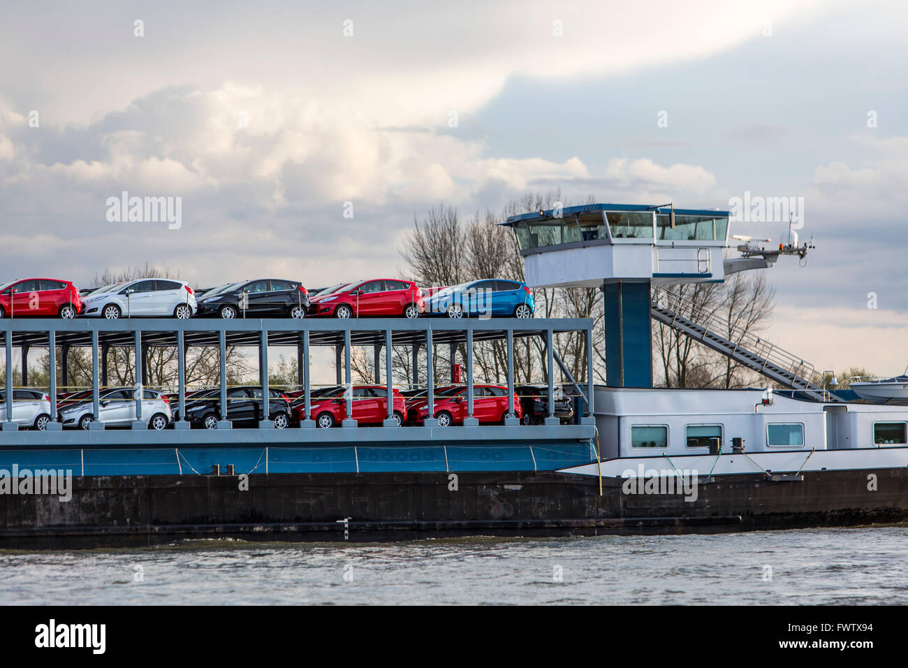 Cargo ship, car transporter on river Rhine, Duisburg, Germany - Stock Image