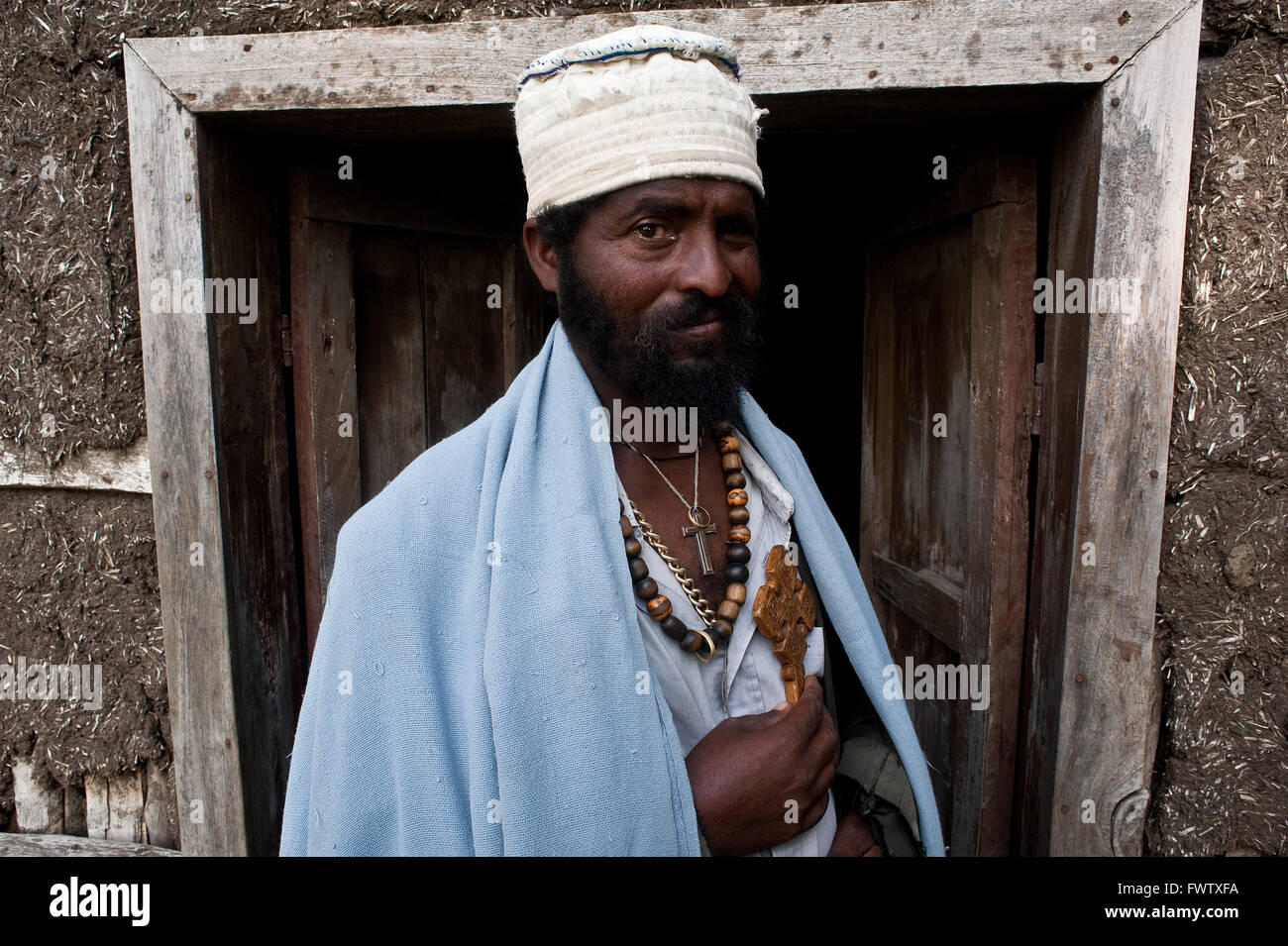 Orthodox monk working as a traditional healer. His role is to help the people having problems to get rid of evil - Stock Image