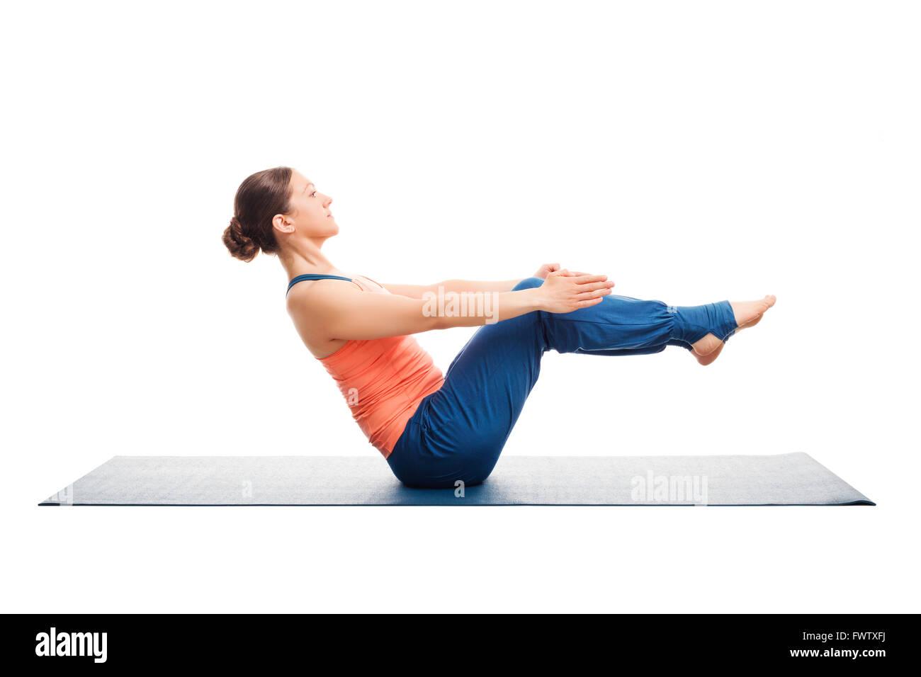 Sporty fit woman doing Ashtanga Vinyasa yoga asana Paripurna nav - Stock Image