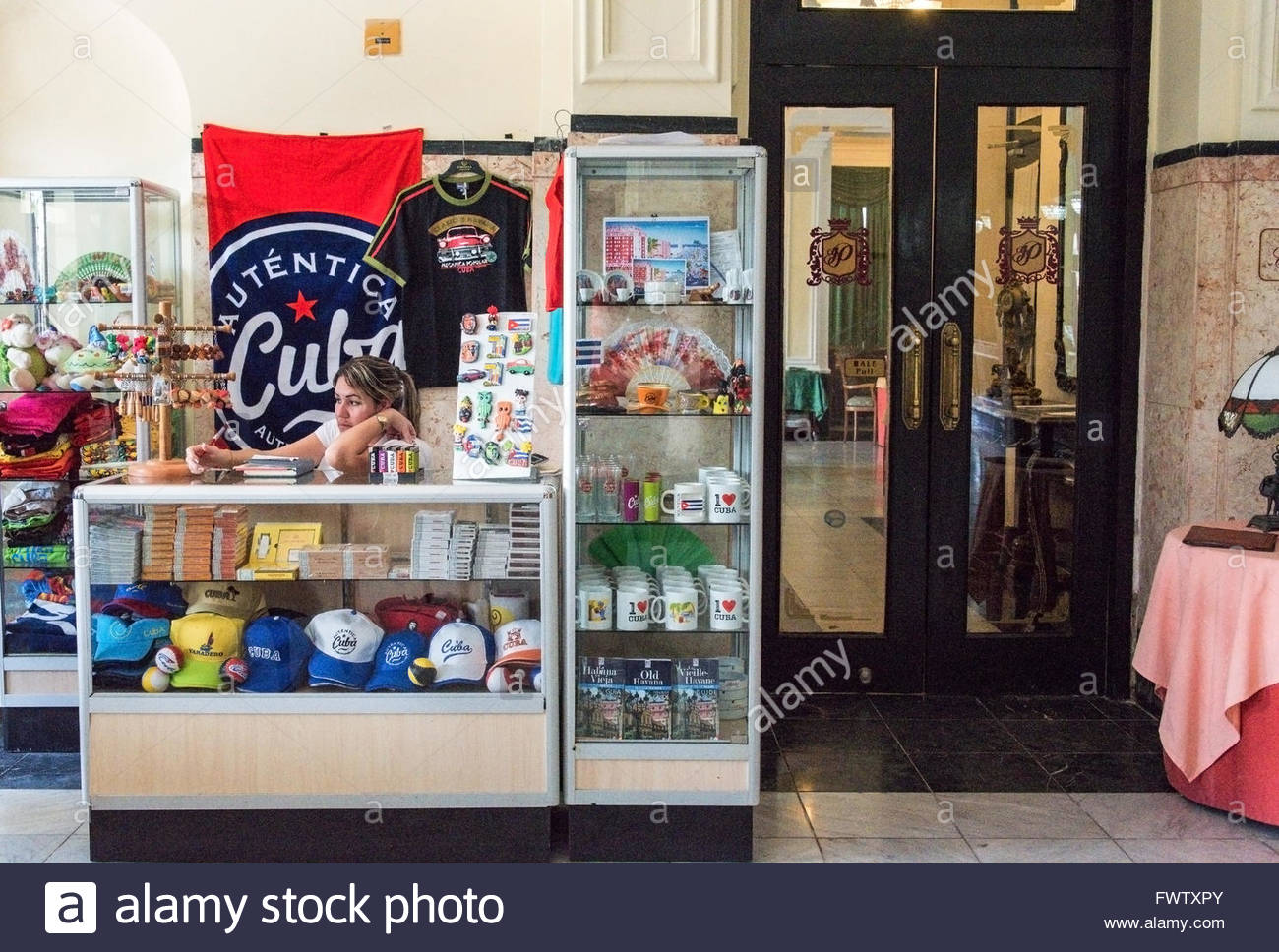 Cuban souvenirs stand selling hats and mugs. Most tourists enjoy purchasing souvenirs as memory. - Stock Image