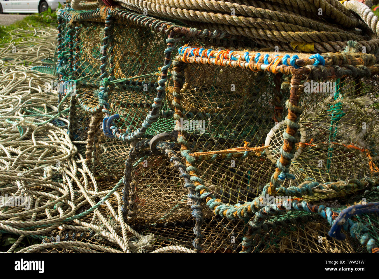 Fishing traps pilled up on the pier in a Scottish fishing town. - Stock Image