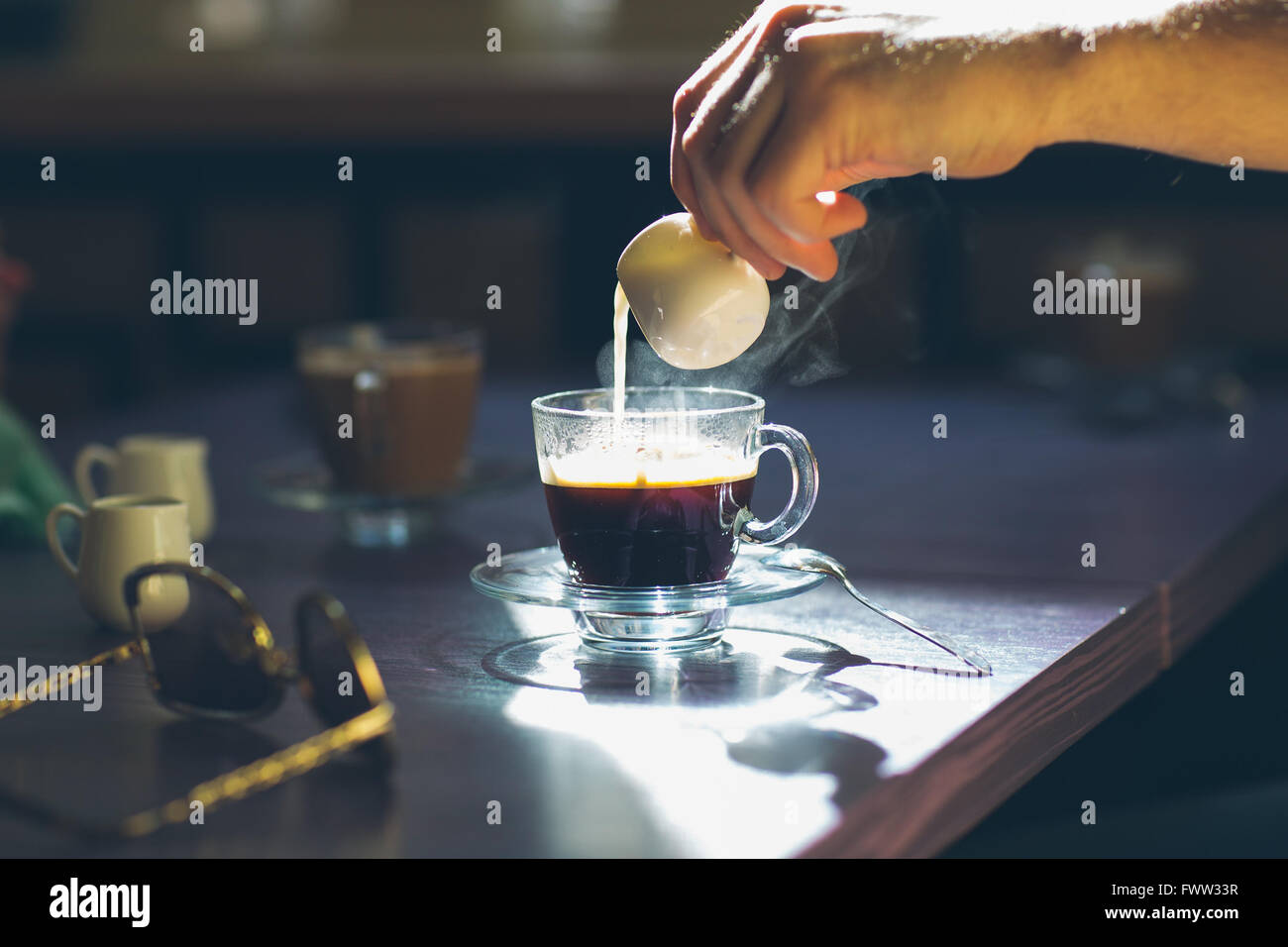 coffee with cream on table - Stock Image
