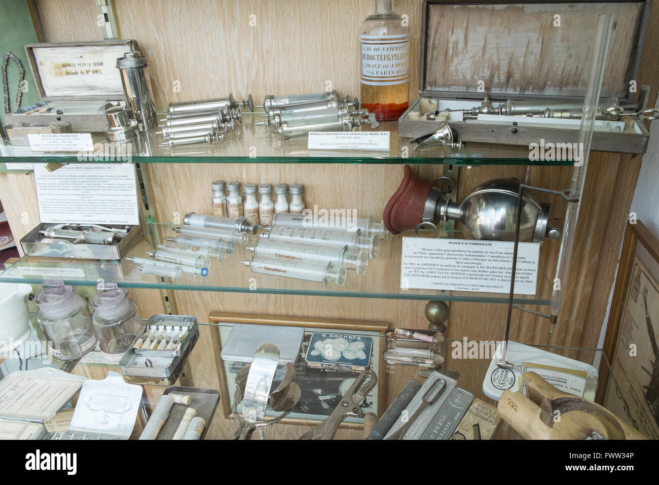 Antique surgical instruments,tools on display in window at pharmacy