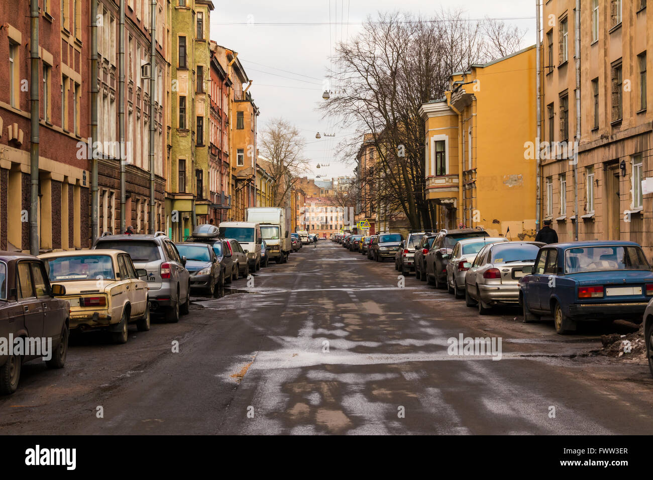 St. Petersburg, Russia - March 10, 2016: View of Vitebskaya street with parked cars on roadsides in wet spring day Stock Photo