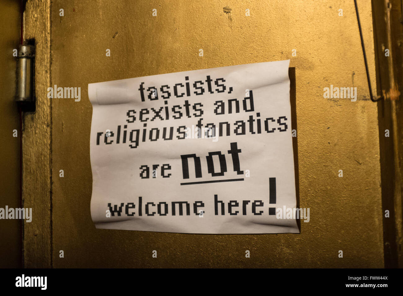 Anti Homophobic sign in a bar, Berlin, Germany - Stock Image