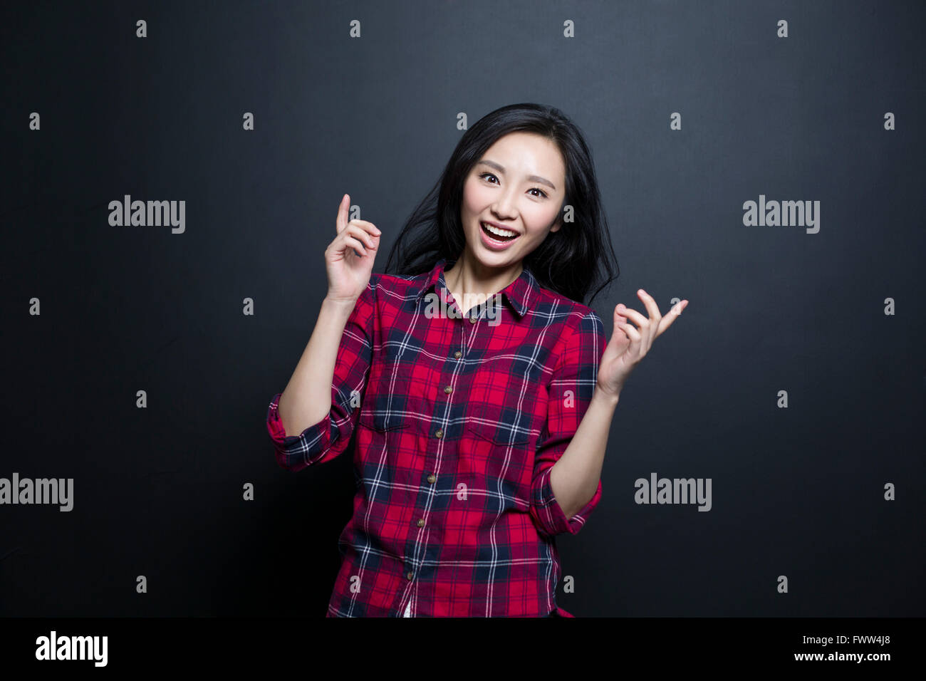 Excited young woman - Stock Image